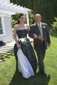 Custom-Made Tartan Gown This elegantly styled gown is custom-made to order in Scotland. We can have it made for you in any light weight premium wool tartan we have available. This is not your traditional one-time-use wedding dress. You can wear it to other formal occasions after the wedding! The gown is made in two parts — a bodice and a skirt. Both are fully lined with white or cream silk. The bodice is extensively boned and laces up in the back for easy adjusting. This gown is exquisite in…