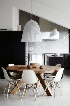 Serious rattan pendant light shade and gorgeous timber table.