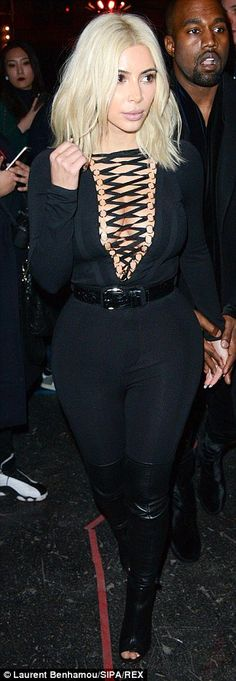 Seen before: During Paris Fashion Week, Kim has worn several eye-catching and cleavage bar...