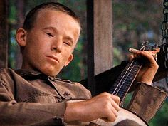 Billy Redden 1972 film Deliverance. He was 16 when he filmed the movie and was paid five hundred dollars.