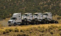 Truck hauling trucks..