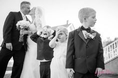Such a funny and cute photo with the bride and groom and their flower girl and ring bearers! | Lynda Berry Photography