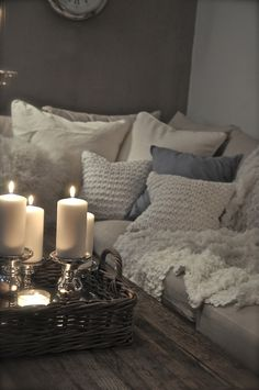 comfy and neutral - grays, whites, wood, and candles.