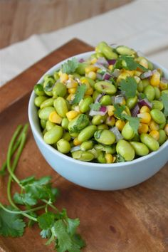 2 cups frozen, shelled edamame 1 can corn 1/2 medium red onion (or to taste), finely chopped 2 handfulls chopped cilantro 2 tbs EVOO 2 tbs balsamic vinegar 1/2 tsp crushed garlic 2 tbs lemon juice 1/4 tsp grated fresh ginger salt and pepper to taste Simmer edamame in 2 cups of water and a pinch of salt on medium heat for 4 minutes.  Chill 5 min Combine EVOO, balsamic, garlic, lemon juice, ginger, salt & pepper in a bowl and whisk together. Add edamame, corn, red onion and cilantro. Mix.
