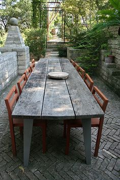 Lovely long outdoor dining table. james david and gary peese - in the garden, austin. Been to this garden. Just gorgeous.