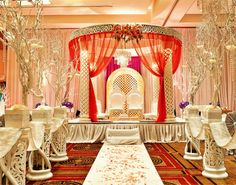 I like this one, but without the draping.  Like the way the aisle is done with the aisle pieces and draping between then.