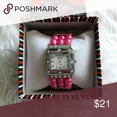 Pink Pearl bracelet watch Cute Faux Pink Pearl bracelet watch embellished  Rhinestones!! Elastic stretch band. Nice casual or formal event accessory to pair with an inspirational T-Shirt top or your formal apparel. Great gift idea!! NIB Discounts available---Offers Welcomed Accessories Watches