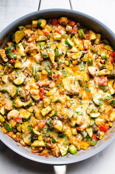 Low carb chicken and zucchini recipe cooked in one skillet with black beans, corn, fresh herbs, taco seasoning and melted cheese on top. #cleaneating #healthy #recipe #recipes #zucchini #lowcarb #keto