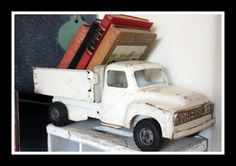love the vintage truck with books