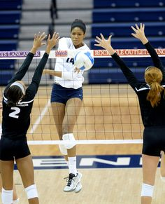 PENN STATE – ATHLETICS – Aiyana Whitney spikes the ball for No. 3 women's volleyball team during Alumni Classic tournament celebrating 50 years of women's varsity athletics at Penn State.