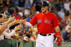 Sox slap - Boston Red Sox's Travis Shaw high fives fans after his second home run of the game Boston's 15-1 win over the Seattle Mariners Aug. 14. - © Winslow Townson/AP