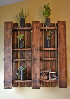 shelves made out of painted recycled pallets