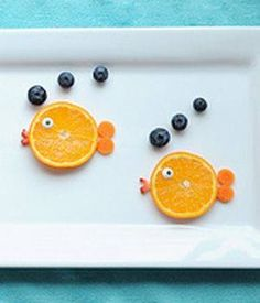 Too cute!  Make little fish snacks out of oranges and blueberries