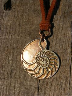 Nautilus Necklace. Acid Etched Coin Pendant made from a U.S. Quarter.. $43.00, via Etsy.