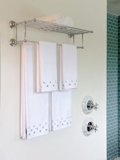 Blog Cabin 2012: Master Bathroom Pictures: A polished chrome towel rack, selected by online voters, lends a hotel-style finishing touch to bathroom interiors. The polka-dot print of plush cotton towels complements the color of shower tile. From DIYnetwork.com