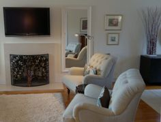 Delightful Bright And Fresh Living Room With Pier 1 Chas Armchairs And Cercis  Fireplace Screen
