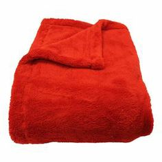 "Perfect draped over the sofa or at the foot of your bed, this cozily textured throw features a reversible design and rich red hue.    Product: Throw Construction Material: 100% Polyester  Color: Red     Dimensions: 50"" x 70"""