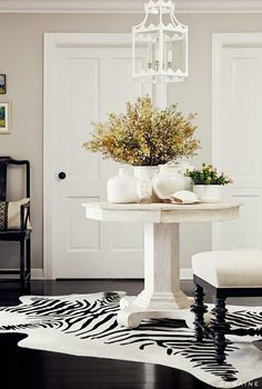 White center hall table with zebra hide.
