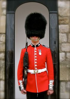 welsh guardsman wearing his summer guard order red tunic in 2018