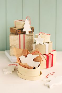 Scandinavian style is one of the most popular for Christmas, and today we going to make Scandi-style ornaments. You'll need air dry clay, a cookie cutter, a rolling pin, a pin or toothpick, scissors, ribbon or twine, quick dry glue. Roll out clay with rolling pin until it is about a 1/4″ thick. Cut shape...