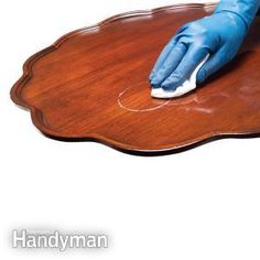How to Remove Stains In Wood Furniture • A wet glass on fine furniture can create a white ring that no amount of cleaning erases. Before you resort to paint stripper, try rubbing it with a soft rage moistened mineral spirits. Read more: http://www.familyhandyman.com/woodworking/furniture-repair/how-to-remove-stains-in-wood-furniture/view-all#ixzz38qEOkILv