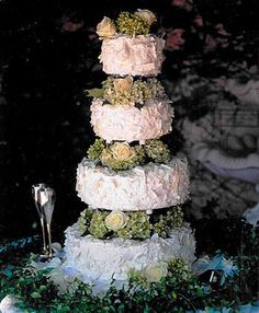 4-tier finished with White Chocolate Shavings, Fresh Hydrangeas and Roses
