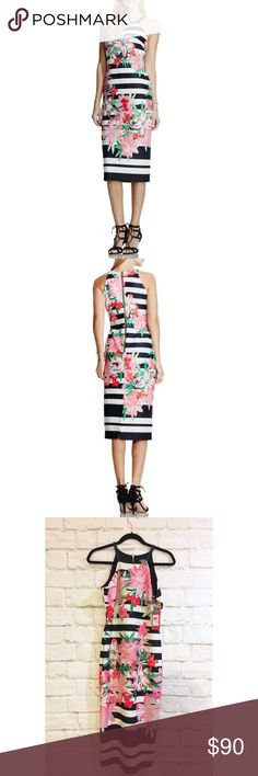 """Vince Camuto stripes and lilies fitted midi dress Awesome pink floral lily pattern and bold black and white stripes. Body Con shape in Scuba material.new with tags, sold out. 17"""" bust , 14"""" waist ,45""""length, hips 18 1/2"""" Vince Camuto Dresses Midi"""