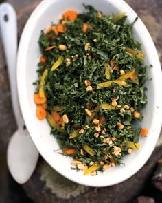 An untraditional take on coleslaw, this salad has thinly sliced kale tossed with crunchy bell pepper and carrot slices. The slaw is finished with a salty peanut dressing and adds a fresh, vibrant note to your barbecue plate.