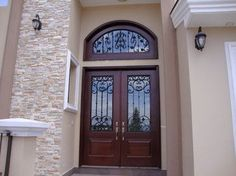 "6' x 8' tall Alder Entry Doors with wrought iron, opaque glass and a transom with 6"" legs."