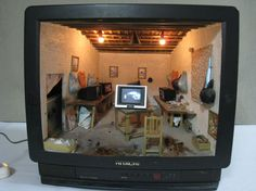 Living in a shoebox | Chinese artist makes miniature rooms inside discarded televisions