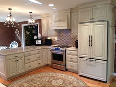 Custom White Kitchen Cabinetry with Appliance Facing