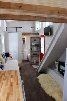 """CLICK ON """"PHOTO GALLERY"""" FOR MORE PHOTOS. This beautiful tiny house will go fast! Originally priced at $41,999. Construction cost came under budget, we are passing the savings on to you! Save over $2,000! Specifications: -2015 year built.-Approx Weight 10,500-11,000 lbs. -Trailer size: 8'x24′ 5 1/2″ x 1/4″ thick steel frame, with trailer breaks. -All…"""