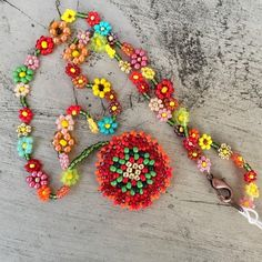 """I love the colors in this necklace. I made it with glass and gemstone seed beads. The chain is 18"""" long and can be worn without the medallion. The medallion is about 2"""" long. It has a copper lobster c"""