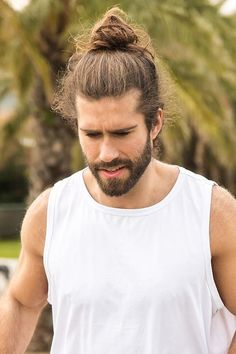 Looking for the best way to don your man bun? We've prepared a bunch of hot men bun ideas to match any taste and beard style, from funny and messy top knot wedding hairstyles to Asian and black undercut buns with braids. Long Curly Hair Men, Medium Long Hair, Curly Hair Styles, Man Bun Hairstyles, Wedding Hairstyles, Viking Haircut, Braided Man Bun, Messy Top Knots, Shaved Head