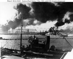 USS Nevada (BB-36) burning in the background after the Japanese attack on Pearl harbor (December 7, 1941)