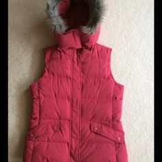 PRETTY PINK PUFFER VEST Pretty pink puffer vest.  Concealed zipper with snap closure.  Two front pockets with snap closures.  Fully lined.  Detachable hood with faux fur trim.  She'll is 100% polyester, lining is 100% polyester.  Fill is 80% duck down cluster, 20% feathers.  Machine wash, tumble dry.  Size petite petite.  23.5 length from center back.  Lots of compliments on this! Talbots Jackets & Coats Puffers
