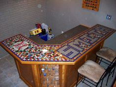Handmade bar top out of beer bottle caps!