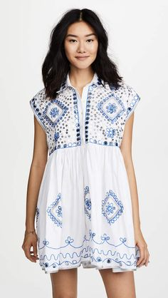 Juliet Dunn Embroidered Poncho Shirt Dress. Bring some boho glamour on your next beach vacation. (You know you want to!) This airy cotton Juliet Dunn cover-up dress will glitter in the sunlight all day long. #ad #fashion #style #dress #minidress #minidress2018 #floraldress #bohodress