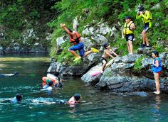 Children cool off in the Kurosongawa river in Shimanto, Kochi Prefecture, which experienced a record-high temperature of 41 degrees on Aug. 12. (Hitoshi Kikuchi)