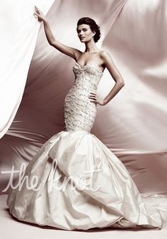 Gown features beading, box-pleated skirt and bubble hem.