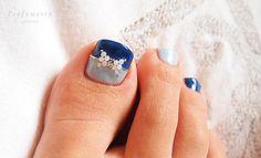 foot nails , ribbon , blue