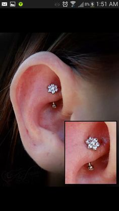 Rook with a CZ flower from Anatometal.