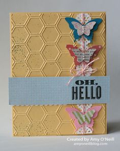 Stamps:  Oh, Hello  Ink:  Basic Black, Island Indigo (splatters)  Paper:  So Saffron, Whisper White, Island Indigo, Pretty in Pink, Tea for Two dsp  Embellishments:  Honeycomb Textured Impressions Embossing Folder, Delicate Details Lace Tape, Elegant Butterfly punch, Bitty Butterfly punch, Dotted Scallop Ribbon Border punch, Pearl Basic Jewels, Calypso Coral Baker's Twine, Color Spritzer Tool