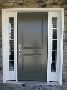 Wood blinds in a sidelight widonw of a front door.