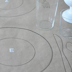 Brown paper on tables, draw outlines of plate and kids have to draw themselves or something on them.