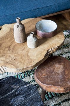 Ceramic urns and vases on wood stump coffee tables
