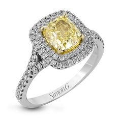 This lovely engagement ring features a cushion shaped double halo design set with .54 ctw of white diamonds.