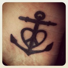 Anchor, cross, heart, and peace sign all combined tattoo