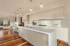 Luxury Modern Home Interior Design in Melbourne : Sleek Kitchen Designed with Long White Kitchen Island Modern Kitchen Lighting, Modern Kitchen Island, Kitchen Pendant Lighting, Kitchen Pendants, Modern Kitchen Design, Interior Design Kitchen, Pendant Lights, Long Kitchen, Nice Kitchen