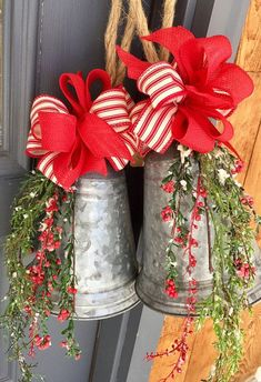 Rustic Christmas elegance with weepy greenery, small red berries and a candy striped bow and a thick, knotted jute rope for hanging. Buy just one or a set of two. Great price point for hostess gifts, teacher gifts, coworkers Farmhouse Christmas Decor, Primitive Christmas, Rustic Christmas, Vintage Christmas, Christmas Bells, Christmas Holidays, Christmas Wreaths, Christmas Lanterns, Christmas Angels